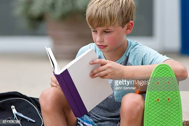 Schoolboy reading a book