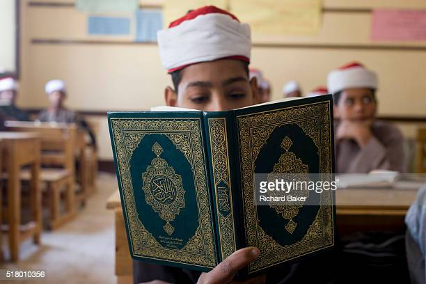 A schoolboy recites Arabic verses from the Koran in a classroom at the Islamic Koom alBourit Institute for Boys in the village of Qum on the West...