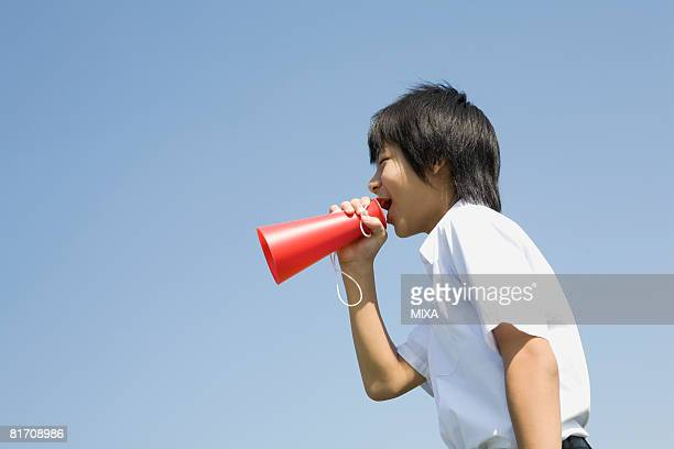Schoolboy shouting with megaphone