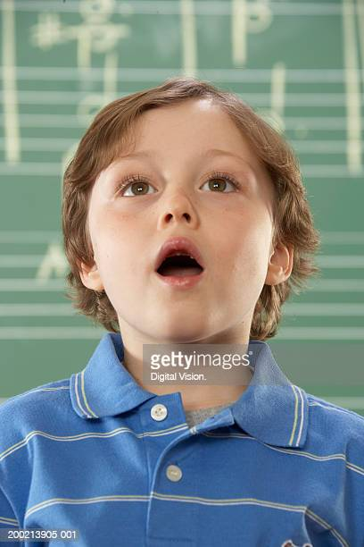 Schoolboy (5-10) singing, close-up