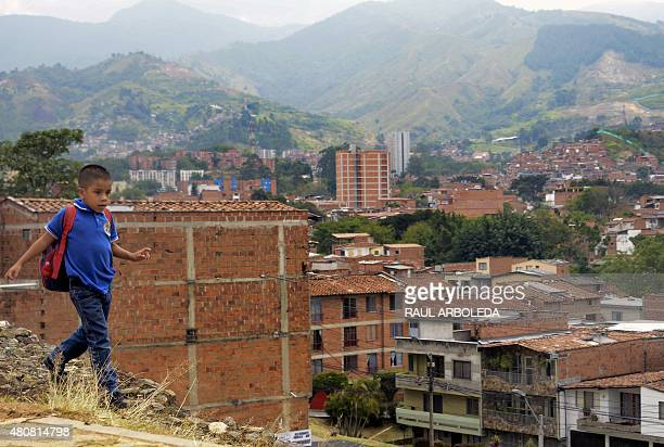 A schoolboy walks at the 13 Commune shantytown in Medellin Antioquia department Colombia on July 15 2015 In 2002 Medellin was rocked by violence...