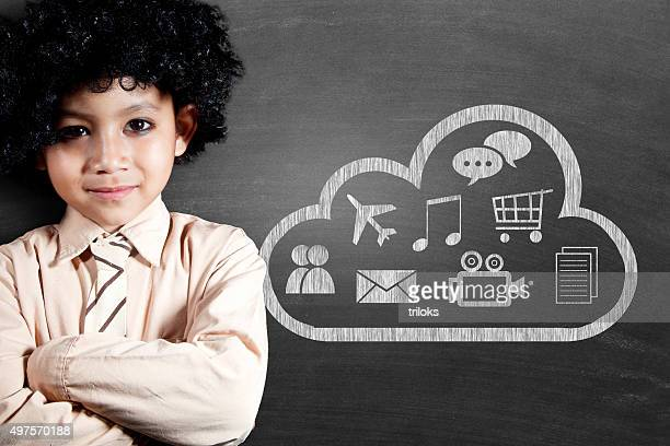 Schoolboy with cloud computing icon drawn on blackboard