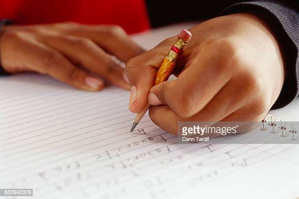 Schoolboy Writing with Chewed-Up Pencil Stub