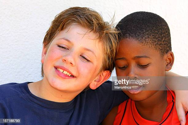 schoolboys best of friends - forgiveness stock pictures, royalty-free photos & images