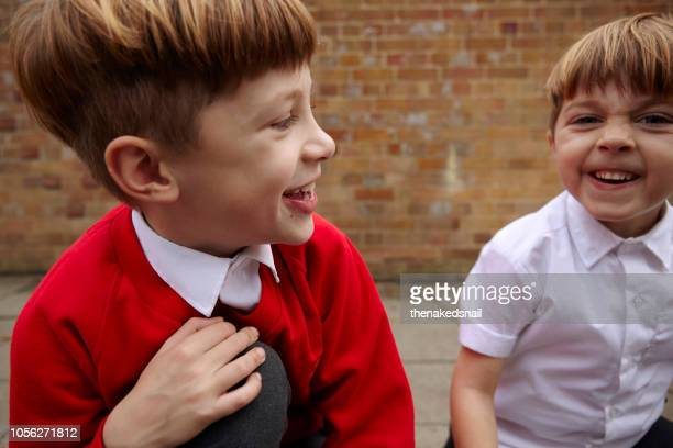 schoolboys having fun - britain playgrounds stock pictures, royalty-free photos & images