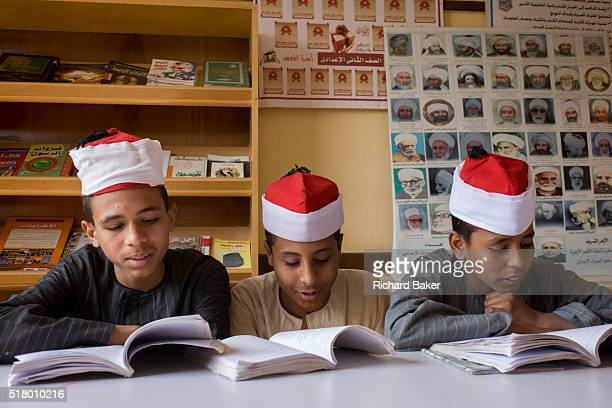 Schoolboys learn verses from the Koran in a classroom at the Islamic Koom alBourit Institute for Boys in the village of Qum on the West Bank of Luxor...