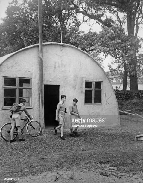 Schoolboys outside a nissen hut used as a temporary classroom at Gordonstoun School in Scotland February 1952 Original publication Picture Post 5679...