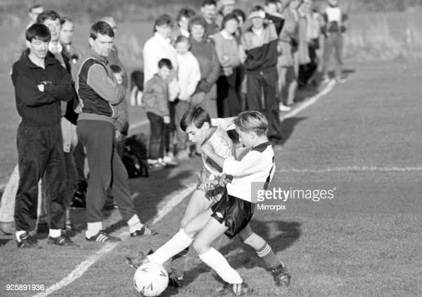 Schoolboys playing football, Nunthorpe and Hemlington battle for possession in the Minor League, 12th November 1988.