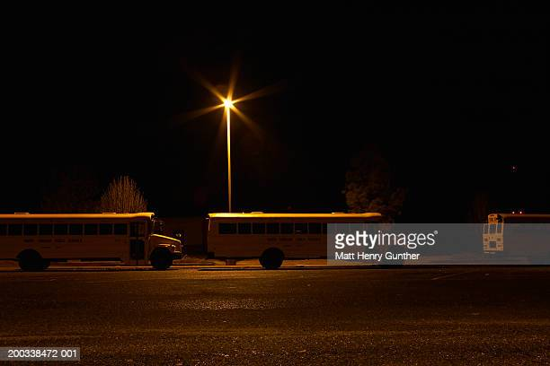 Schoolbuses at night, side view