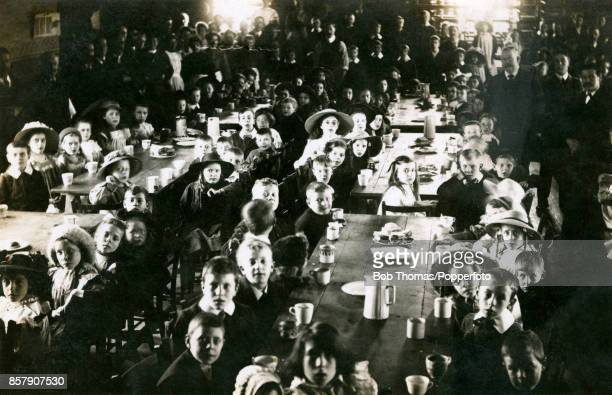 Schoolchidren taking breakfast on Easter Sunday morning in the Cooperative Hall in Netherfield Great Britain during the Ilkeston coal strike on 7th...