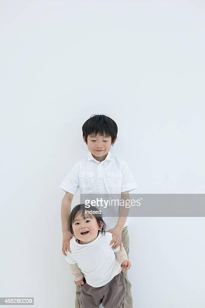 Schoolchild boy and baby