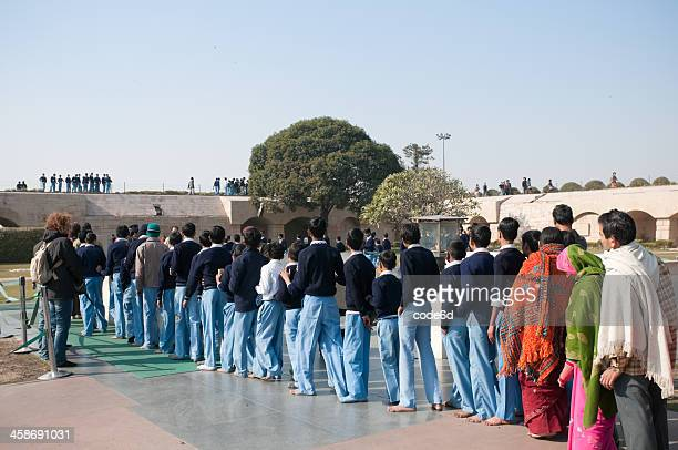 schoolchildren at raj ghat memorial, new delhi, india - raj ghat stock photos and pictures