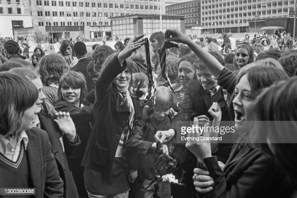 Schoolchildren burning their ties in a protest strike at County Hall in London, organised by the Schools Action Union , UK, 10th May 1972.