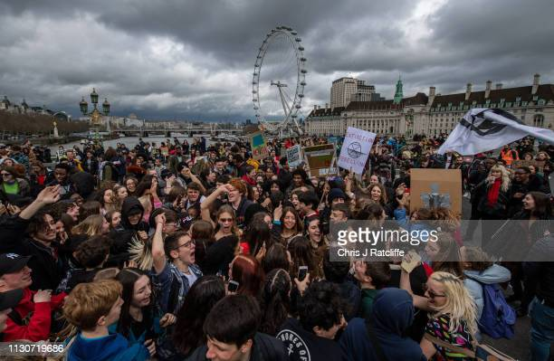 Schoolchildren dance as they block off Westminster Bridge and Parliament Square whilst taking part in a student climate protest on March 15 2019 in...