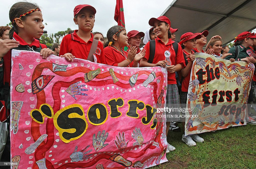 Schoolchildren display a banner reading : News Photo