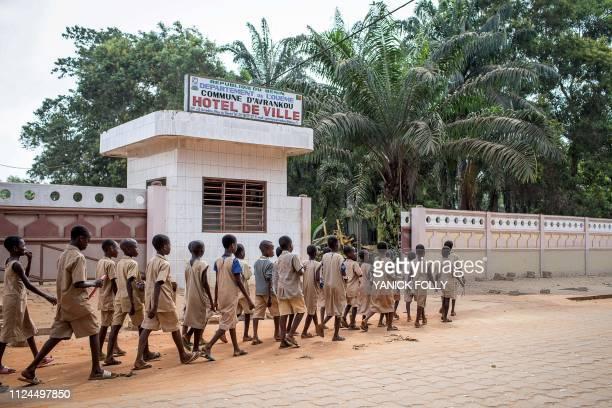 Schoolchildren from AvrankouHoueze school arrive at Avrankou city hall to attend a BloLab training in Avrankou south of Benin on January 18 2019...