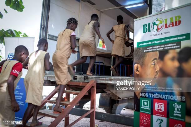 Schoolchildren from Avrankou-Houeze school enter the BloLab container to attend a training, at Avrankou city hall, in Avrankou, south of Benin, on...