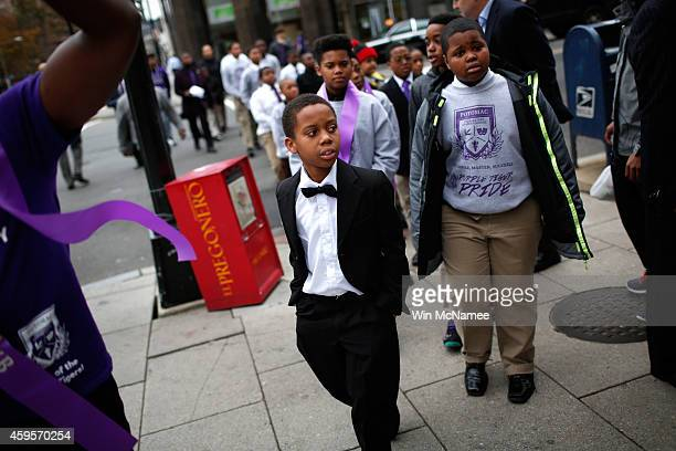 """Schoolchildren from the Potomac Preparatory Charter School arrive for a protest outside the Office of Police Complaints as part of a planned """"28..."""