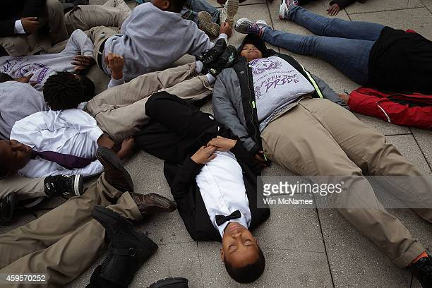 """Schoolchildren from the Potomac Preparatory Charter School take part in a """"die-in"""" during a protest outside the Office of Police Complaints as part..."""