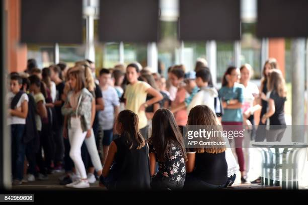 Schoolchildren gather in the covered playground at the 'Leo Ferre' secondary school during the start of the new school year in SaintLys suburbs of...