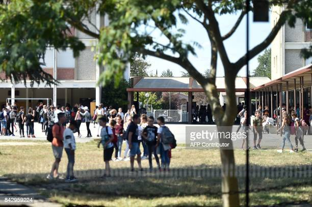 Schoolchildren gather in the playground at the 'Betance' secondary school during the start of the new school year in Muret suburbs of Toulouse on...