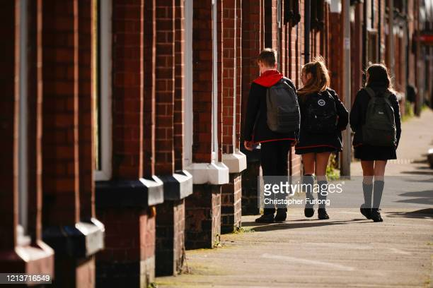 Schoolchildren head home as schools are closed due to the ongoing coronavirus pandemic on March 20, 2020 in Northwich, England . Coronavirus has...
