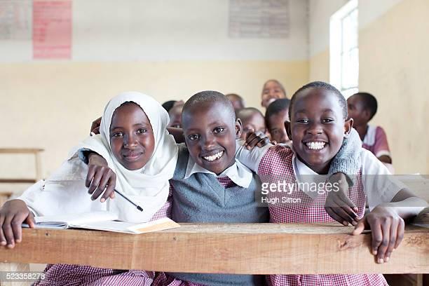schoolchildren (8-9) in primary school, maasai area, kenya - hugh sitton stock pictures, royalty-free photos & images