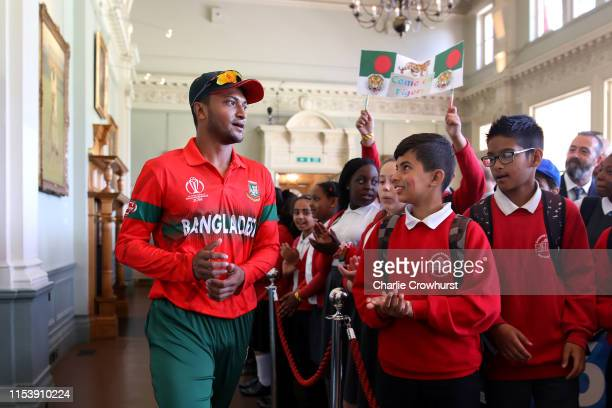 Schoolchildren in the Pavilion at Lord's with Bangladesh's Shakib Al Hasan on July 5 2019 in London England History was made at Lord's when local...