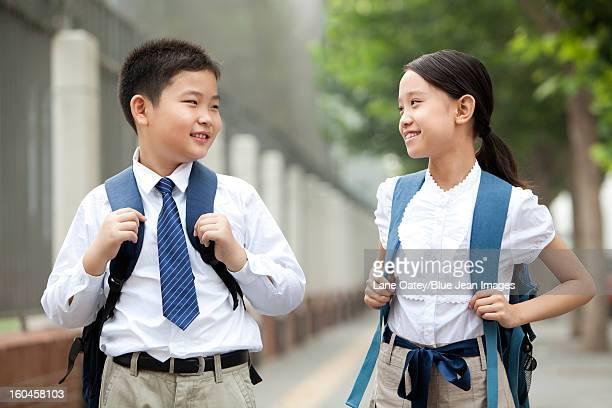 Schoolchildren in uniform on the way to school