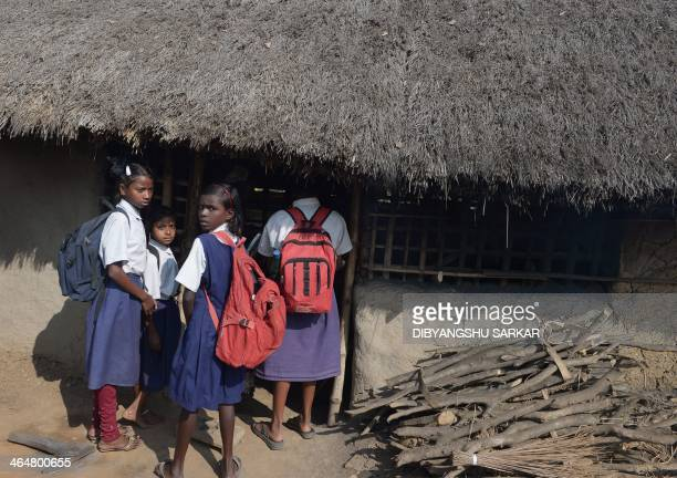 Schoolchildren look on from a village shopfront following an alleged gangrape in Subalpur village in Birdhum district some 240 kilometres north west...