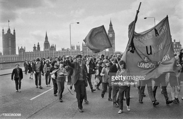 Schoolchildren marching across Westminster Bridge for a protest strike at County Hall in London, organised by the Schools Action Union , UK, 10th May...