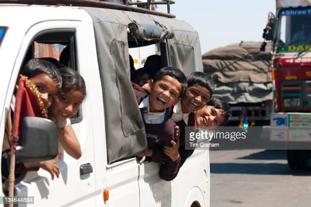 Schoolchildren on Delhi to Mumbai National Highway 8 at Jaipur Rajasthan Northern India