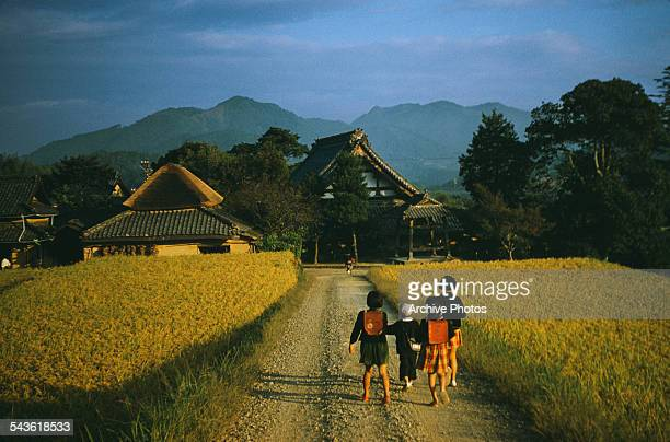 Schoolchildren on their way to school in the small village of Saita Iyo Province on Shikoku island Japan circa 1965