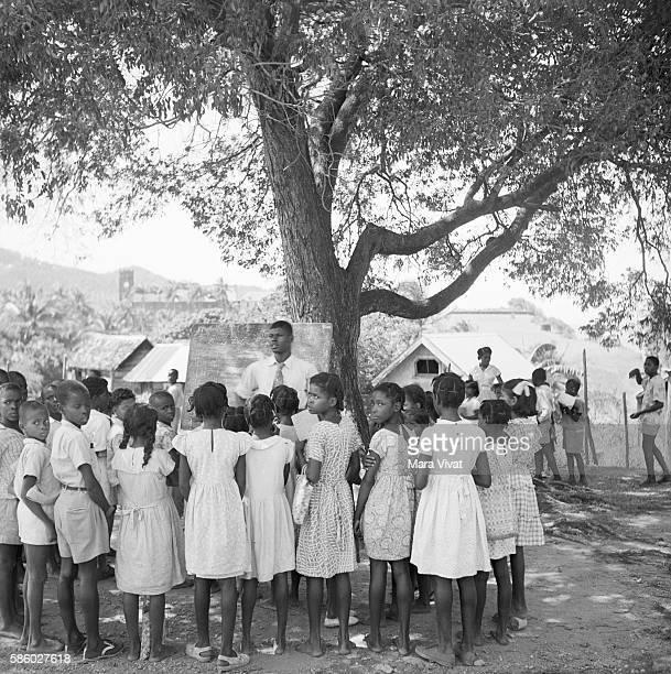 Schoolchildren Outside Encircling Teacher Grenada