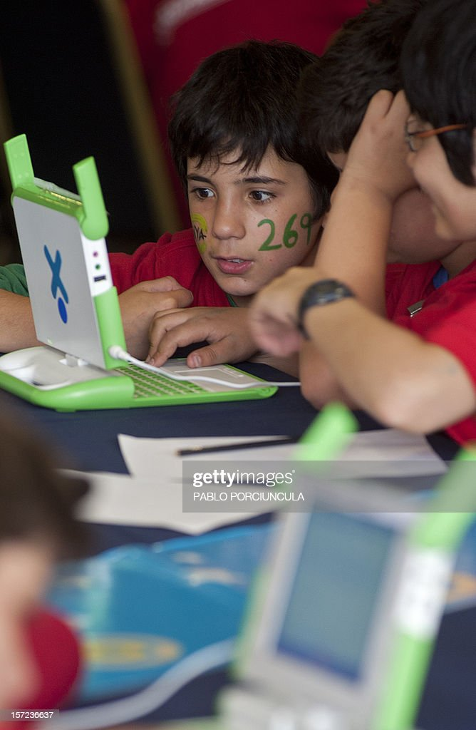 Schoolchildren participate in the second Mathematics Marathon of the 'Ceibal Project', on November 30, 2012 in Montevideo. The Ceibal Project is the Uruguayan equivalent to the 'One Laptop per Child' project, through which every public primary schoolchild is equipped for free with a personal computer and free access to an educational net. AFP PHOTO/Pablo PORCIUNCULA