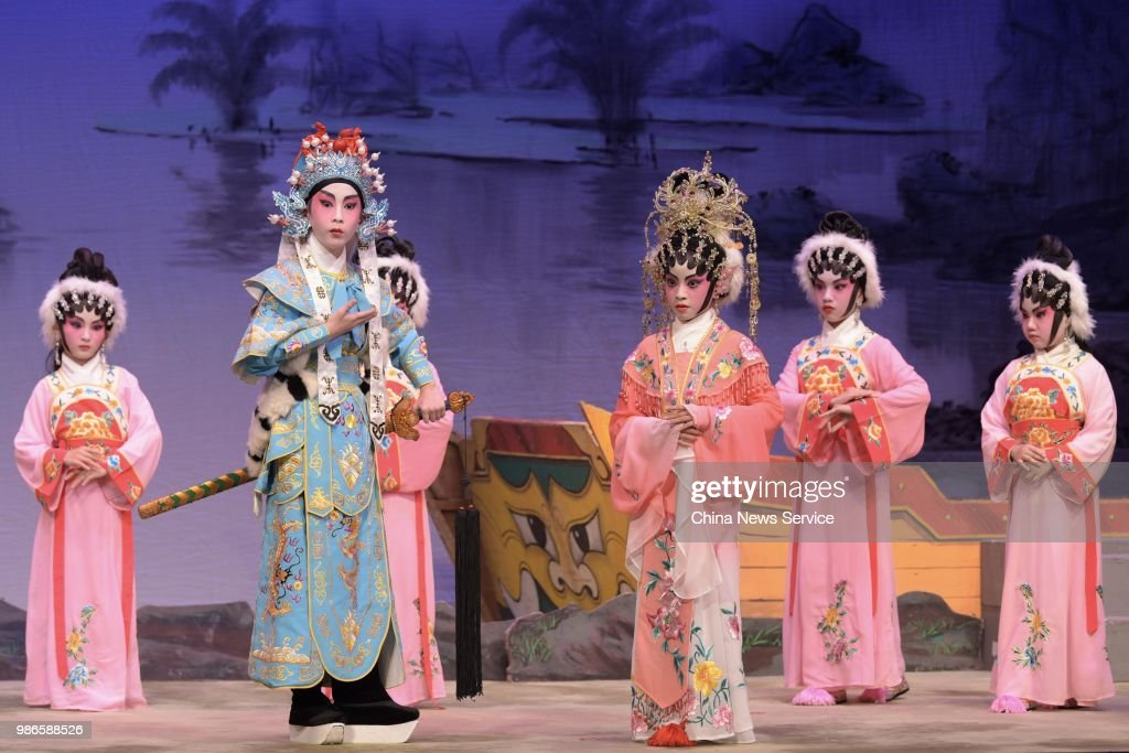 Schoolchildren perform Cantonese opera on the stage on June