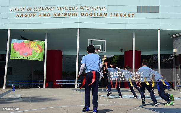 Schoolchildren play a game of flag football in the yard at the Rose Alex Pilibos Armenian School in the Little Armenia neighborhood of Los Angeles...