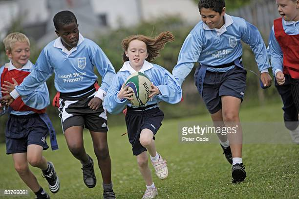 schoolchildren playing rugby - rugby stock pictures, royalty-free photos & images