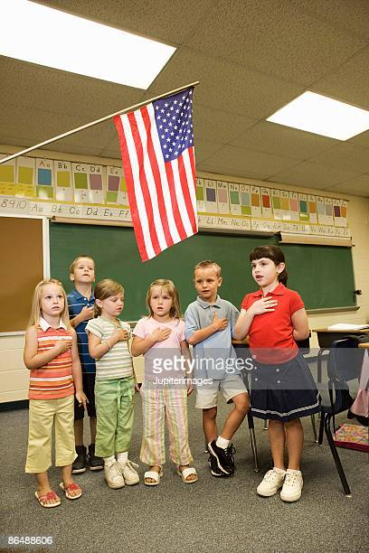 Schoolchildren pledging allegiance to the flag