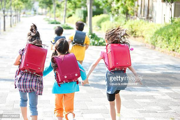 schoolchildren running - children only stock pictures, royalty-free photos & images