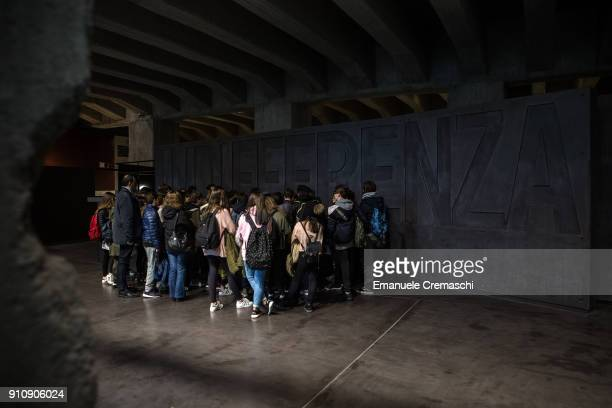 Schoolchildren stand in front of a wall reading 'Indifferenza' as they visit the 'Memoriale della Shoah' on January 26 2018 in Milan Italy In this...