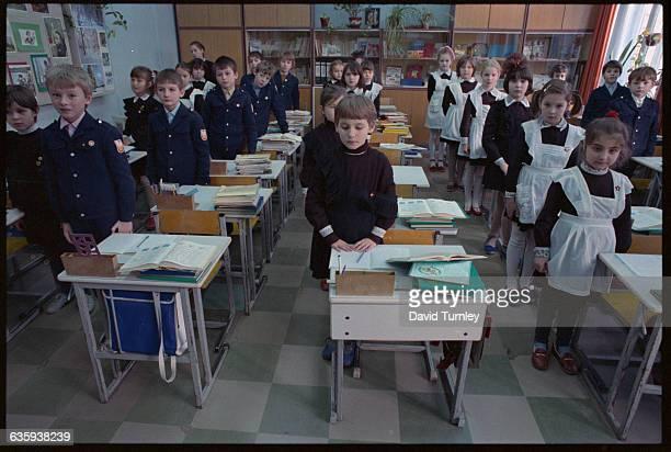 Schoolchildren Standing at Their Desks