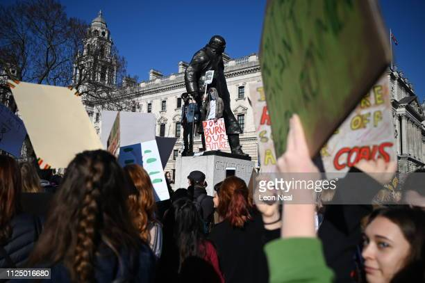 Schoolchildren take part in a student climate march in Parliament Square on February 15 2019 in London England Thousands of UK pupils from schools...