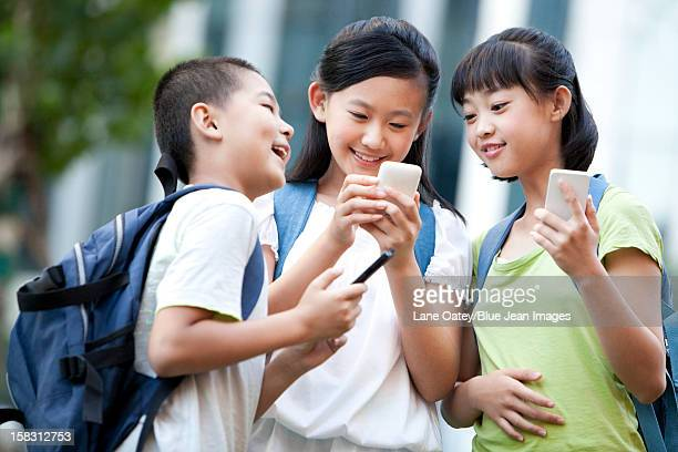 Schoolchildren using smart phones