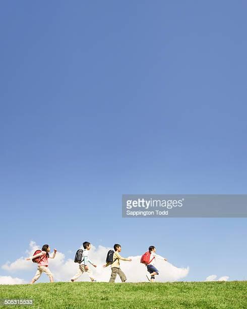 Schoolchildren Walking In A Row