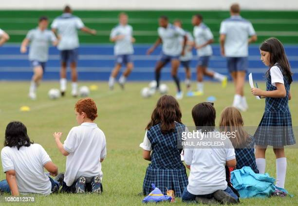 Schoolchildren watch a training session of England's U20 national football team in Medellin Antioquia department Colombia on July 28 2011 England...