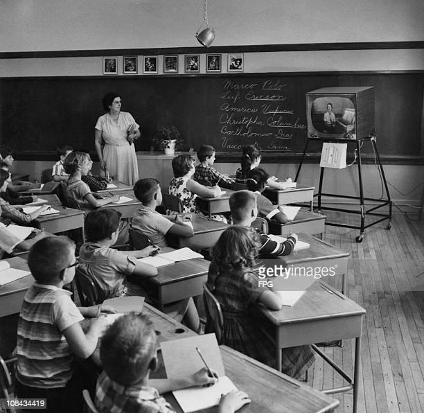 Schoolchildren watching television during a lesson circa 1960.