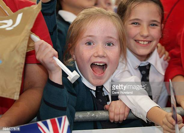 Schoolchildren welcome the athletes during the New Zealand Olympic Games athlete home coming at Auckland International Airport [OR] The Cloud on...