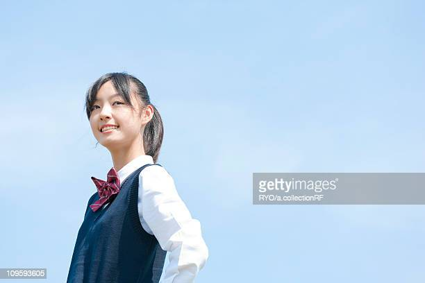 Schoolgirl Against Clear Sky