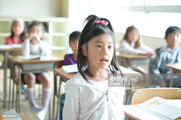Schoolgirl (8-9) answering, looking away